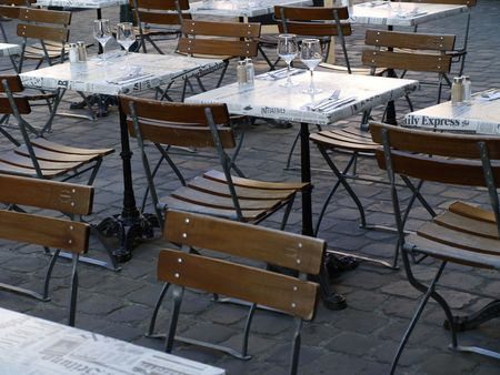 Tables and seats of a cafe. photo