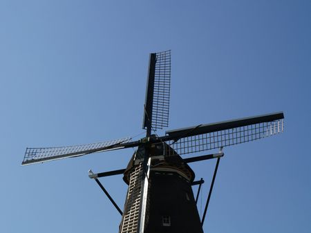 Old windmill with blue sky photo