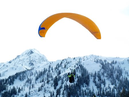 Paraglider with snow covered mountains Stock Photo - 3170728