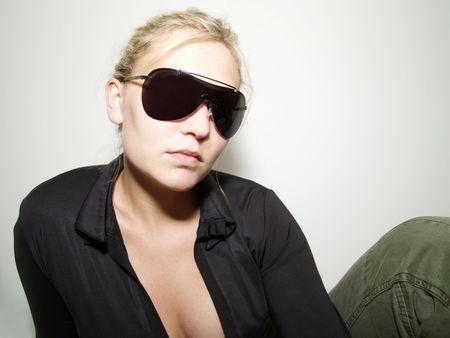 Girl in sunglasses posing