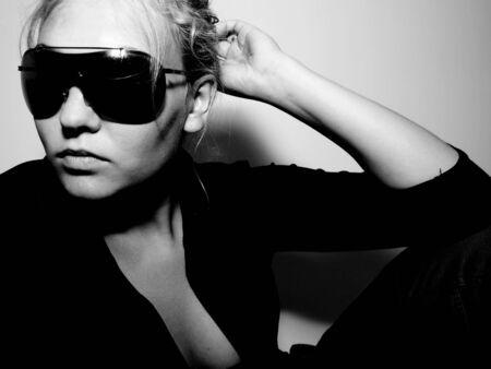 Girl in sunglasses posing                Stock Photo