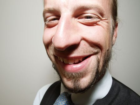 funny smile of a young businessman Stock Photo