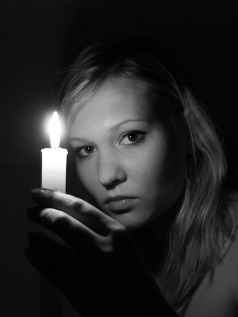 Girl with candle photo