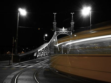 Tram turning on to a bridge      Stock Photo