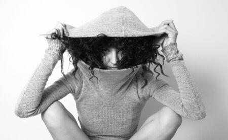 Young girl in hood posing photo