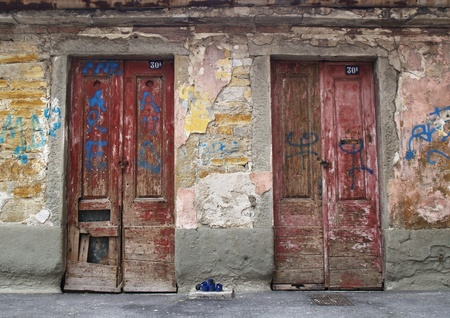 Doors of an abandoned house Stock Photo