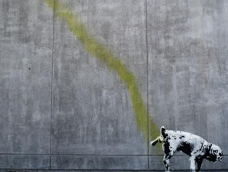 LOS ANGELES, USA - OCTOBER 17: Original Banksy grafitti on a wall (Pissing dog). Los Angeles, October 17, 2011.