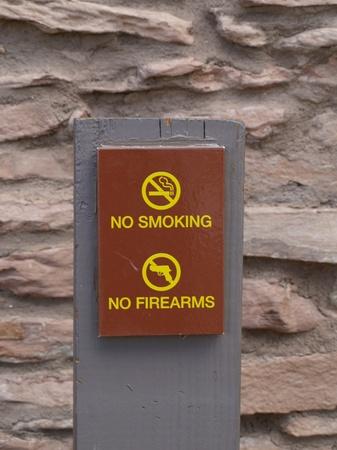No smoking and no firearms sign photo