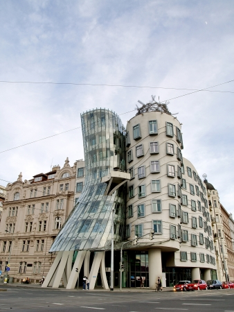 frank gehry: PRAGUE - APRIL 29  The Dancing House in the center of Prague  Seen during gloomy, winter day  The building was designed by Vlado Milunic and Frank Gehry  Built in 1996  Prague, April 29, 2012