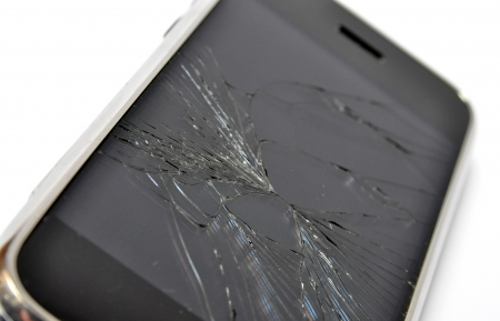 smashed: Mobile phone with broken screen Stock Photo