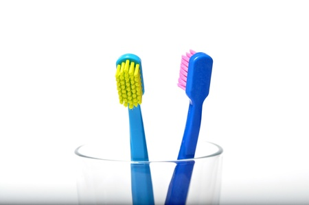 toiletries: Colorful toothbrushes in a glass