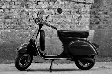 Scooter in front of a wall photo
