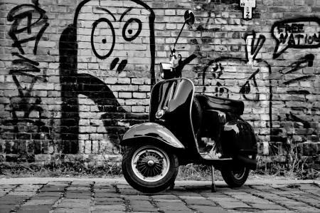 scooters: Scooter in front of a wall