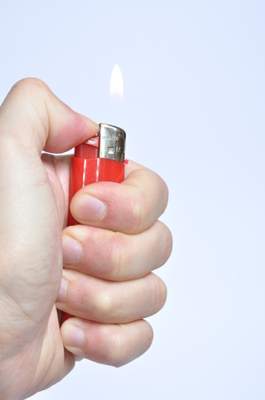 Red lighter in hand Stock Photo - 23252607