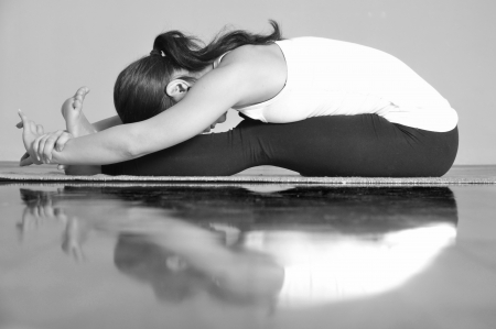 Girl doing Paschimottanasana yoga pose