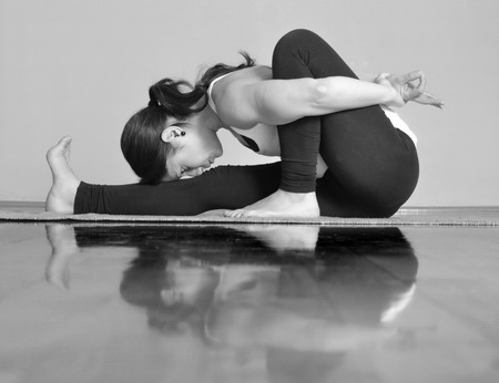 Girl doing Marichyasana A yoga pose