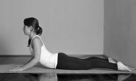 bhujangasana: Girl doing Bhujangasana yoga pose