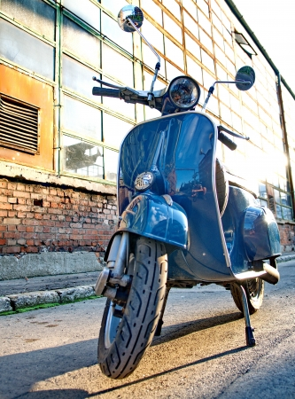 Budapest, HUNGARY - JULY 09: Old Vespa scooter parked in a street in Budapest, Hungary on July 09, 2013
