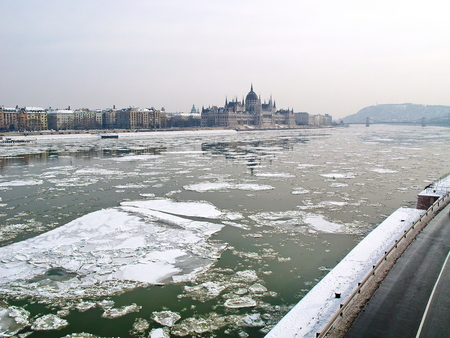 icey: Parliament of Hungary and the icey river of Danube Stock Photo