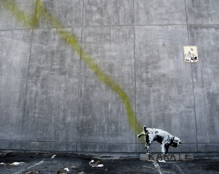 LOS ANGELES, USA - OCTOBER 17  Banksy graffiti on a wall  Pissing dog  on October 17, 2011 in Los Angeles  Banksy Editorial