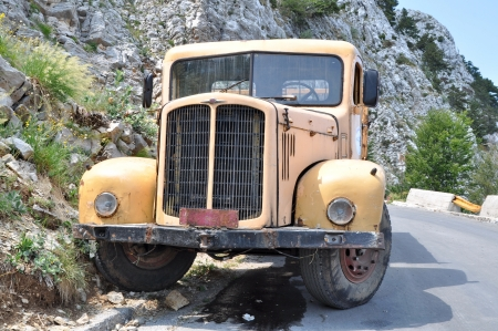 Yellow old truck in the mountain