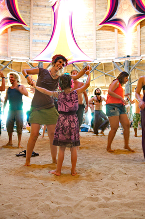 OZORA, HUNGARY - AUGUST 01  Woman and little girl dancing on Ozora Festival, one of the greatest psychedelic music gathering in Euorpe  Ozora, Hungary, Europe August 01, 2014  新闻类图片