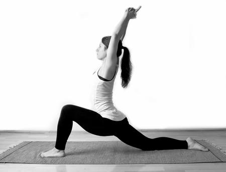 Young girl doing yoga pose photo