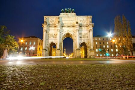 The Siegestor (Victory Gate) at night in Munich, Germany, Europe photo