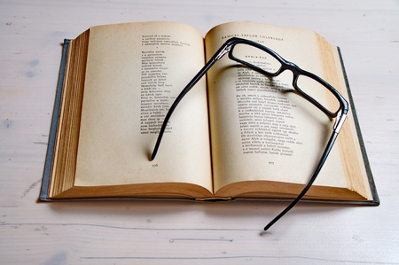 reading glass: Reading glass on an old book