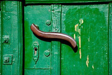 doorhandle: Doorhandle on a green door Stock Photo
