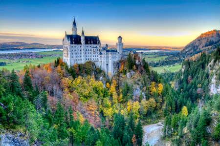 fall landscape: Castle of Neuschwanstein near Munich in Germany on an autumn day