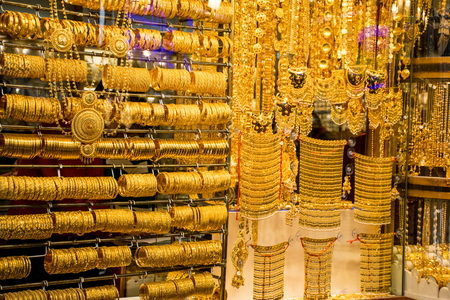 gold souk: DUBAI, UAE - JANUARY 31: Gold on the famous Golden souk in Dubai Deira market on 31 January 2016, UAE. Deira is an old commercial center of Dubai with the biggest street market.