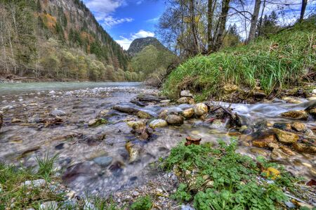 flowing river: Rocks in the flowing river at the mountains Stock Photo