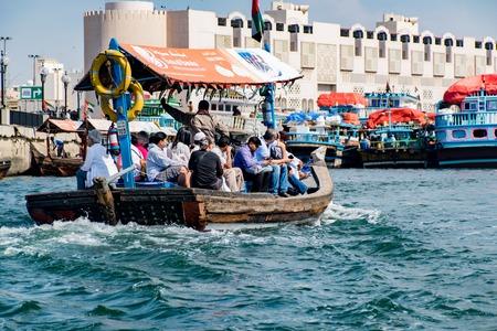 ferries: DUBAI, UAE-JANUARY 31, 2016: Traditional Abra ferries at the creek