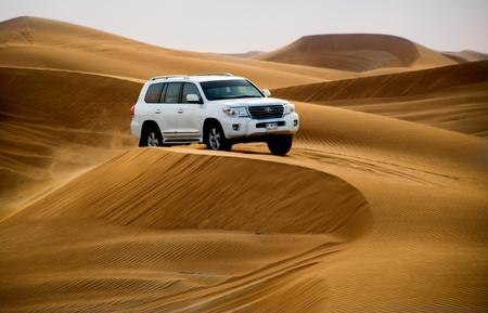 ABU DHABI, UAE - FEBRUARY 01: Desert safari in Dubai, United Arab Emirates. Dune bashing by a 4x4 car is a very popular activity. 免版税图像 - 56614635