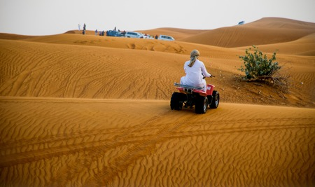 Desert safari in Dubai, United Arab Emirates. Dune bashing by a 4x4 car is a very popular activity. Stock Photo