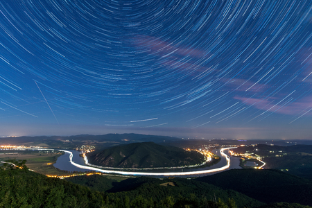 Startrails over a river bend