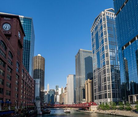 Chicago, IL / United States - Augustl 09, 2017: Tourist boat on the Chicago River among the skyline.