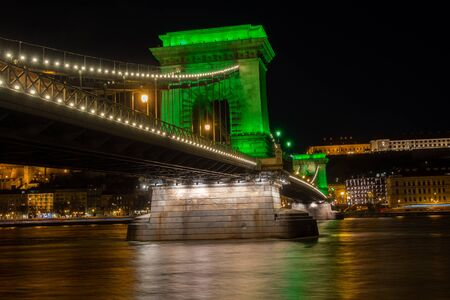 Chain Bridge with green lights on St. Patricks day in Budapest