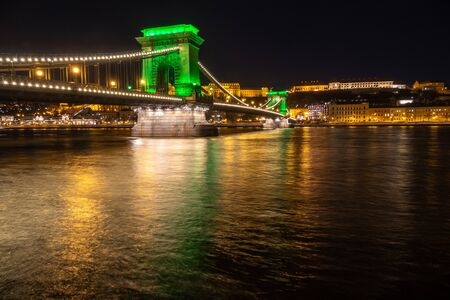 Chain Bridge with green lights on St. Patrick's day in Budapest, Hungary