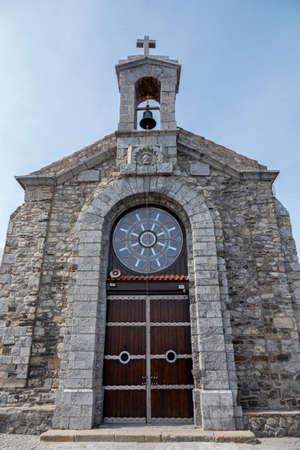 Doniene Gaztelugatxeko hermitage on top of Gaztelugatxe island, Spain Stock Photo