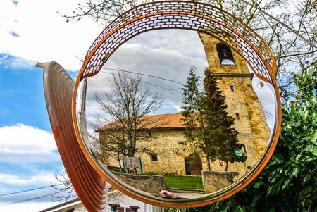 alava: A mirror reflecting the church of Gopegi  Alava, Spain