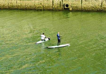 People playing watersports in the Bilbao Estuary, Stock Photo - 19074859