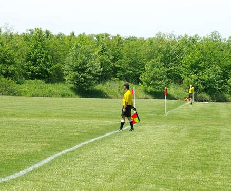 Soccer referees on the side lines Zdjęcie Seryjne