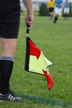 linesman: Soccer Linesman Flag Stock Photo
