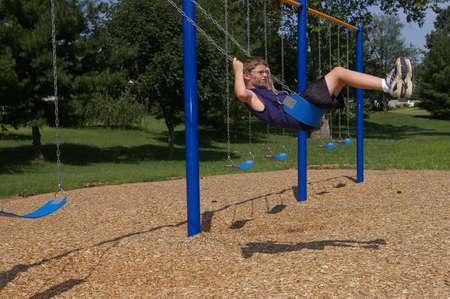 Boy on Swings Stock Photo - 492041
