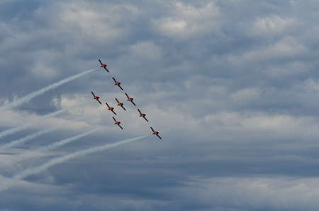 Synchronized acrobatic planes performing at air show in Swift Current, Saskatchewan, Canada