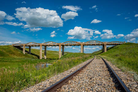 The old concrete bridge in Scotsguard, SK with railway tracks underneath