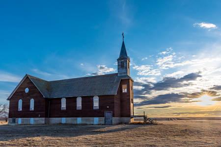 Sunset over the abandoned St. Joseph Parish Catholic Church in Frenchville, Saskatchewan