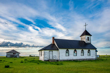 The old St. Marys Mission Church with the old Maxstone school in the background in Maxstone, SK